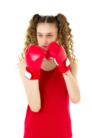 Portrait of girl fighting in red boxing gloves
