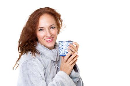 Smiling woman holding porcelain mug