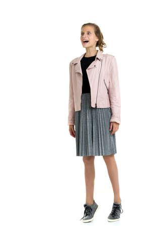Pretty fashionable stylish teenage girl. Isolated over white background.