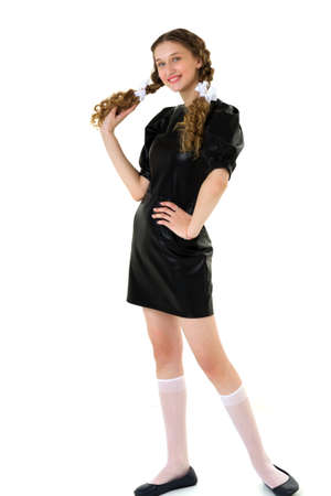 Happy girl in black dress and knee socks Фото со стока