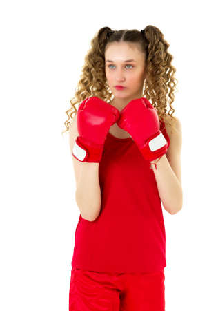 Teen blonde girl fighting in red boxing gloves