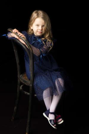 Close up portrait of happy sitting little girl Фото со стока