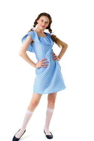 Full length portrait of girl in polka dot dress