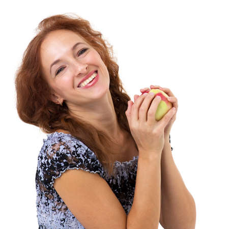 Happy woman holding fresh red apple.