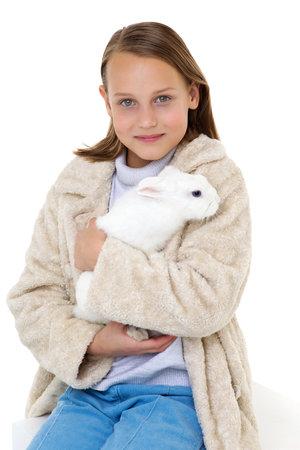 Stylish girl holding white rabbit Фото со стока
