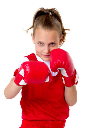 Preteen girl boxing with red gloves Фото со стока