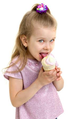 Beautiful little girl eats ice-cream in the summer.