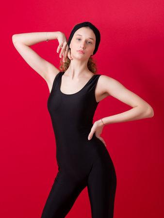 Beautiful slim girl dancer posing in the studio