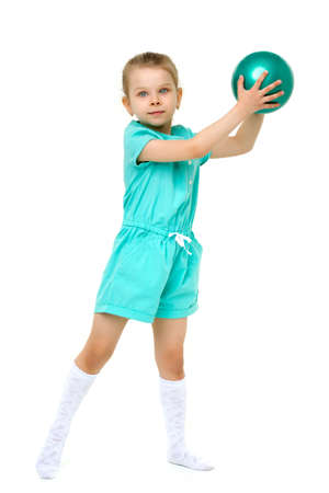 Adorable cute active little girl playing with ball
