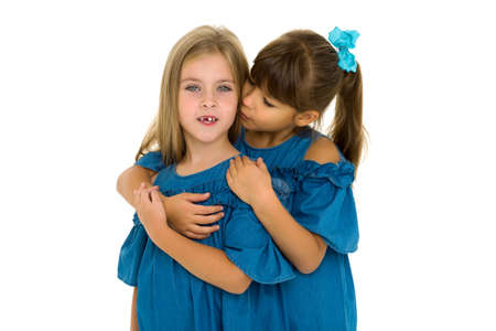 Two happy girls hugging each other