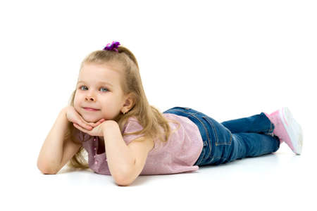 Lovely blonde little girl lying on the floor