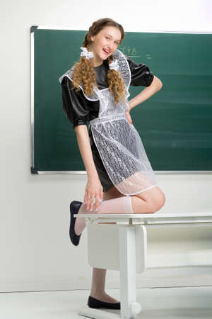 Joyful teen girl student having fun in classroom