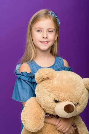 Little girl with teddy bear.The concept of a happy childhood, childrens emotions.