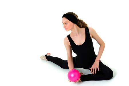 Pretty girl do gymnastics with training pink ball