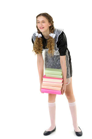 Tired pretty girl carrying pile of heavy books