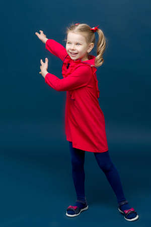 Happy little girl gesturing with her both hands