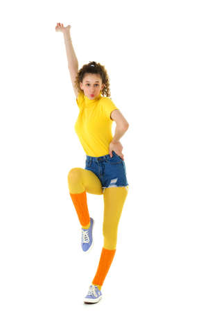 Happy cheerful curly girl in bright sports clothes