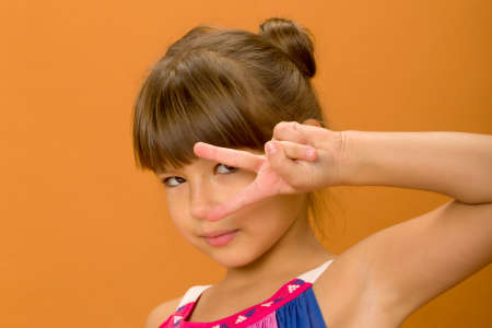 Beautiful girl showing victory signs Фото со стока