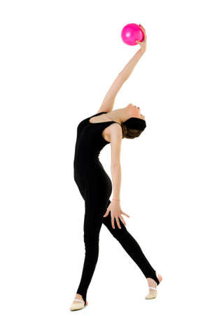Girl in sports outfit doing gymnastics with ball