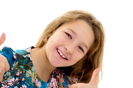 Little girl shows thumb up. Фото со стока