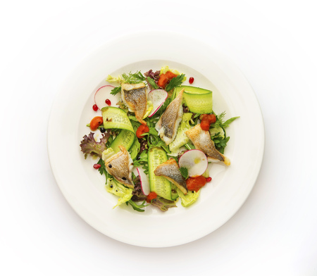 Healthy vegetable salad with fish. Top view on white background