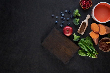 Fresh delicious ingredients for healthy cooking on rustic background, top view, food concept. 写真素材