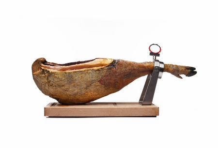 Jamon on a wooden stand isolated on white background