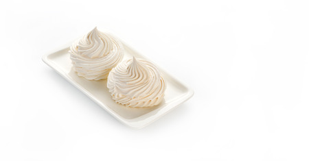French meringue cookies on white background with copy space.