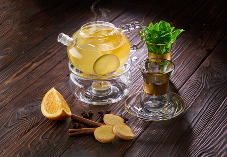 Citrus tea with honey and lemon on wooden table