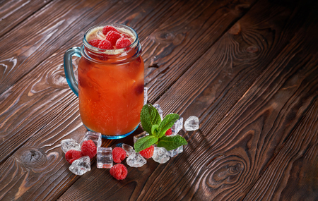 Raspberry smoothie in mason jar on rustic wooden background 写真素材
