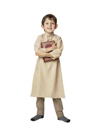 Happy muslim kid holding holy Koran on white background Stock Photo