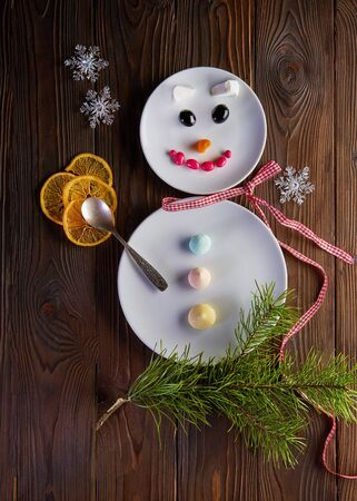 Funny snowman - Christmas and New Year fun food art. Top view