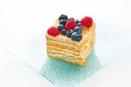 Tasty fruit cake on white background