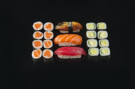 Big set of sushi roll on dark background. Top view.