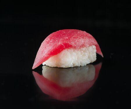 Delicious Sushi Maguro Tuna. Nigiri with tuna on black background.