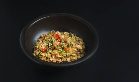 Asian rice in the black bowl with copy space