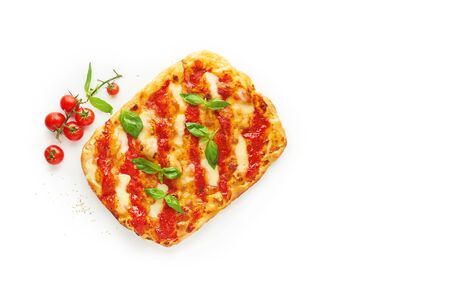 Square pizza or pinza with melted mozzarella cheese and fresh green basil leaves on white background, top view