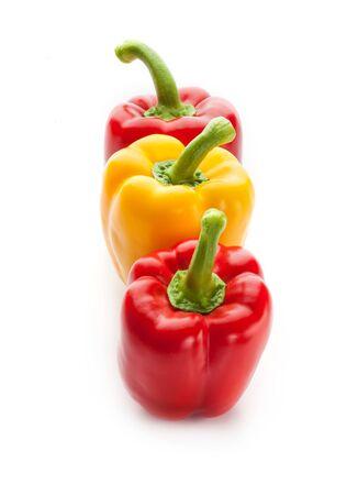 Three fresh sweet pepper isolated on white background