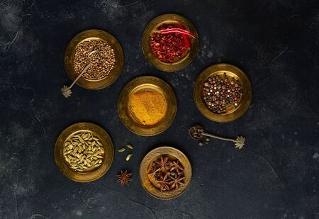 Indian spices in metal bowls, top view, flat lay