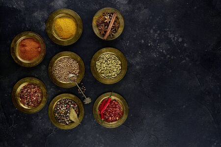 Different spices in metal bowls, top view, flat lay