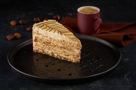 Slice of cake on black background