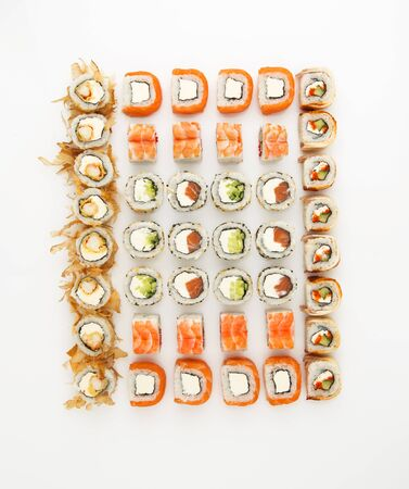 Japanese food sushi roll set isolated on white background. Top view, flat lay