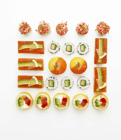 Huge sushi roll set isolated on white background. Top view, flat lay Stockfoto