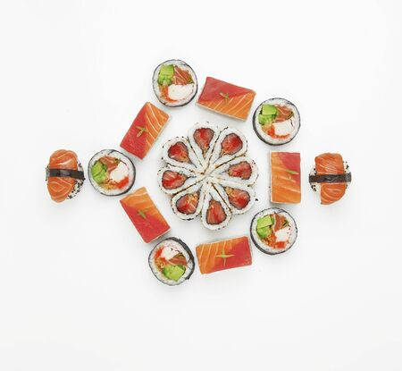 Japanese cuisine. Sushi roll set isolated on white background. Top view, flat lay