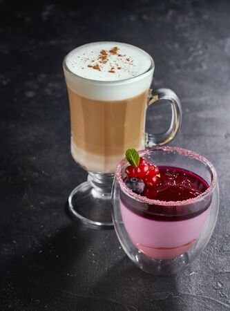 Panna Cotta with a cup of latte coffee on wooden background