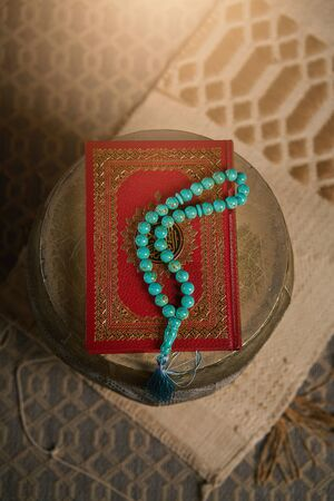 Islamic holy book Quran with rosary beads, muslim faith Allah and prophet Muhammad holy spirit religion symbol concept