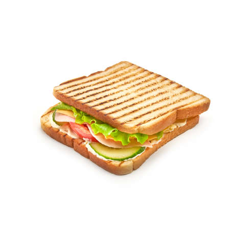 Sandwich with ham, fresh tomatoes and cucumber, cheese and lettuce with toasted bread Isolated on the white background