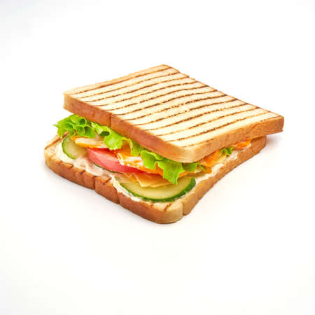 Toast bread sandwich with tomato, chiken, lettuce, cucumbers and yellow cheese on white background Banque d'images
