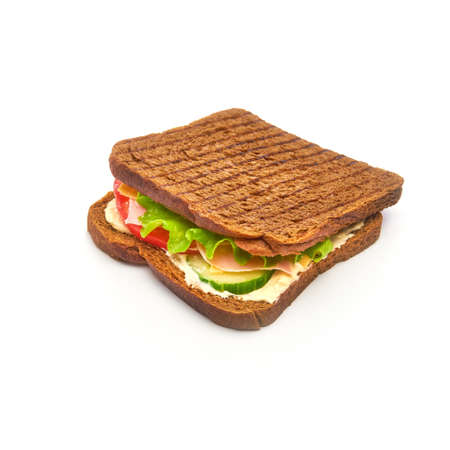 Toast bread sandwich with tomato, ham, lettuce, cucumbers and yellow cheese on white background