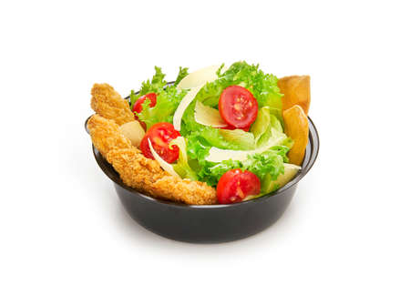 Caesar salad with lettuce, cherry tomatoes, parmesan and fried chicken in plastic bowl isolated on white background, fast food delivery concept for menu Stockfoto - 152316235